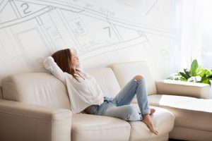 female relaxing on couch in bright home